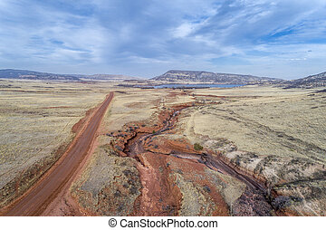 northern Colorado foothills aerial view with a dirt ranch...