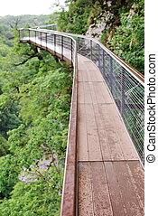 A small pedestrian bridge over the precipice