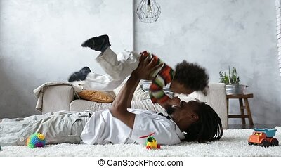 African american father lifting mixed race son up