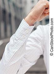 Close up of a businessman's shirt cuffs. Closeup of a hand...