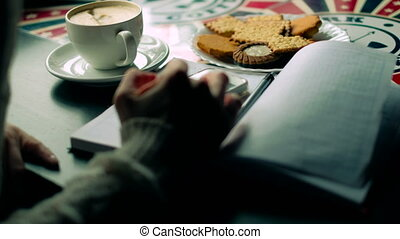 A girl in a cafe drinks cappuccino phone 4k - A girl in a...