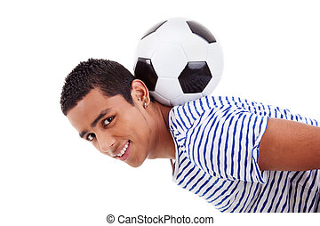 handsome latin boy holding a soccer ball, isolated on white, studio shot