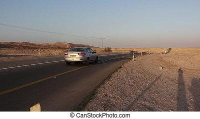 car pass in the desert - Shot of car pass in the desert