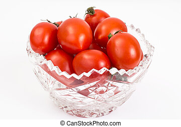 Small red tomatoes in crystal bowl. Studio Photo
