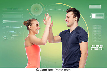 happy sportive man and woman making high five - sport,...