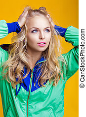 portrait of beautiful blond woman in casual colorful vivid...