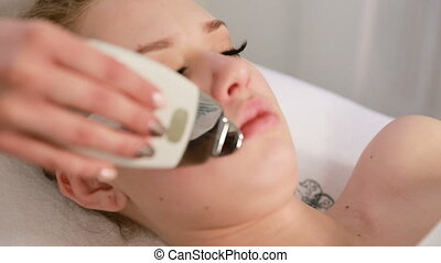 Rejuvenation of the skin rich in the patient in the clinic cosmetology. Cosmetic Procedures On The Face