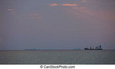 Cargo ship - A small cargo ship sails at a great distance...
