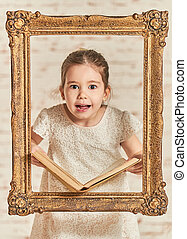 Expressive young little girl reading a book - Indoor...