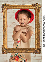 Indoor portrait of an expressive adorable young little girl...