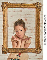 Indoor portrait of an expressve adorable young little girl...