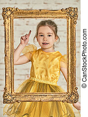 Expressive adorable young little girl seen from an wooden...