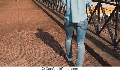 Young pretty women walks on street in Rome, Italy in a sunny...