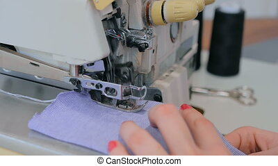 Close up shot of overlock sewing machine - Professional...