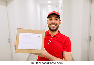 delivery man with parcel box in corridor