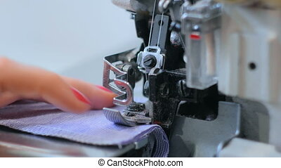 Close up shot of overlock sewing machine