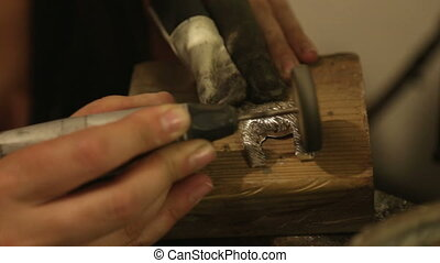 Brass grinding at jewelry workshop - Shot of Brass grinding...