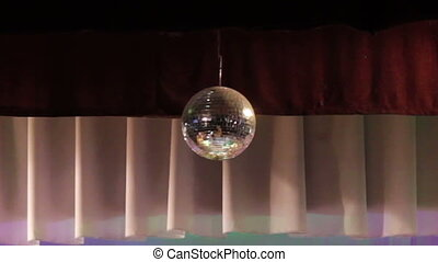 Mirror ball reflects white light. Disco ball with reflected moving rays