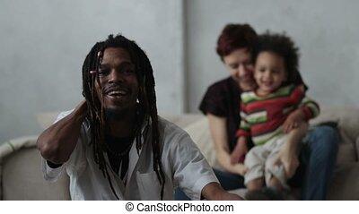 Loving mixed race family enjoying time together - Stylish...