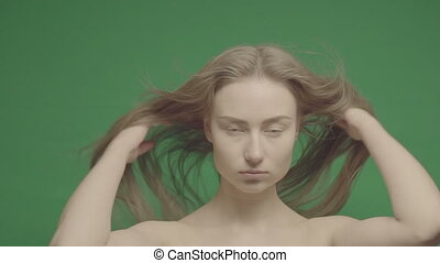 Beauty portrait of woman face on a green background...