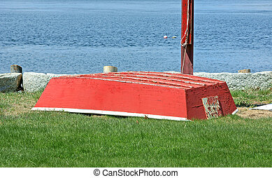 Red skiff - An old red skiff upside down near the ocean