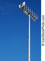 Sporting Field lights on top of tall steel pole with dark...