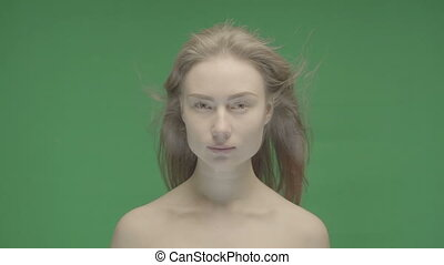 Beauty portrait of woman face on a green background Hromakey