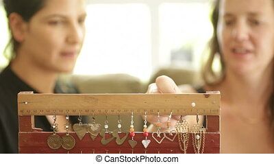 Artist with self made earrings - Shot of Artist with self...