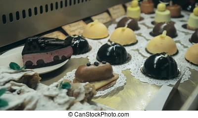 Showcase of cakes, pastry in window display canteen for...