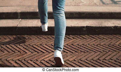 Woman tourist runs on steps in Rome, Italy and take pictures of Colosseum, Konstantin s arch on smartphone. Slow motion.