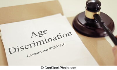 Age Discrimination verdict folder with gavel placed on desk of judge in court