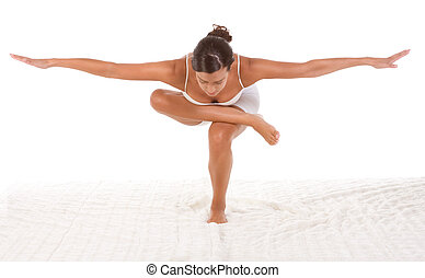 yoga pose - female in sport clothes performing exercise -...