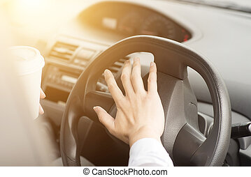Human hand on steering and honking - Concept photo of close...