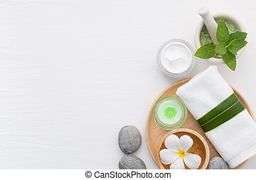 Spa concept with salt, mint, lotion, towel, candle, stone...