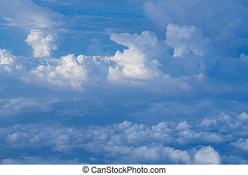 White clouds over blue sky