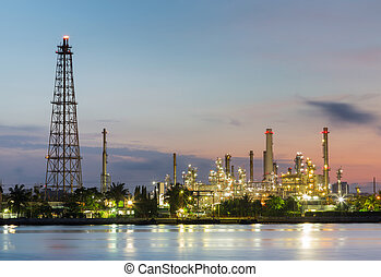 Oil refinery factory with sunrise sky background