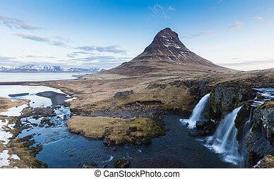 Kirkjufell volcano mountain with waterfall, Iceland winter...