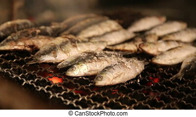 Fresh fish on the grill with smoke - Shot of Fresh fish on...