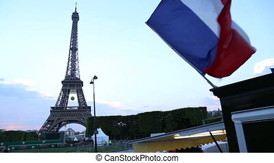French flag with The Eiffel In Paris - Shot of French flag...