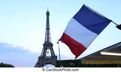 French flag And The Eiffel Tower In Paris - Shot of French...