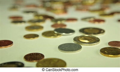 Coins dropping on the table - real time footage.