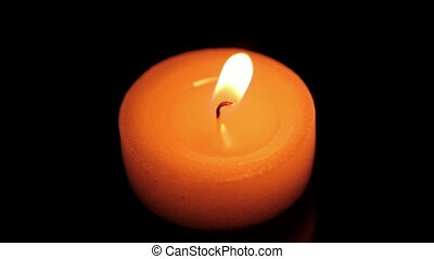 Isolated candle in the dark