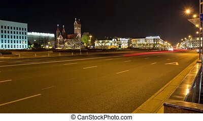 Night traffic on Independence square. Time lapse shot in motion