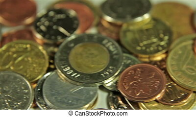 Coins on the table. Close up slider shot.