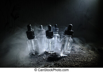 Vape concept. Smoke clouds and vape liquid bottles on dark...