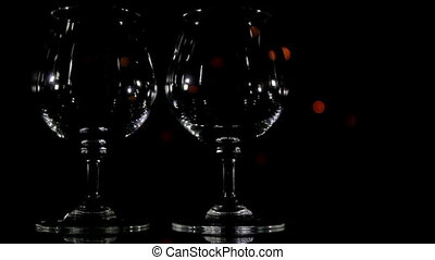 Wineglass and slow light background.