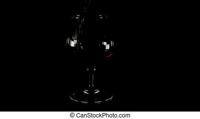 Red wine to wineglass. Real time footage.