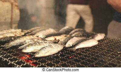 Flipping fish on grill - Shot of Flipping fish on grill