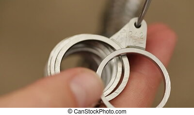 Finger Size Measuring Rings detail shot - Shot of Finger...