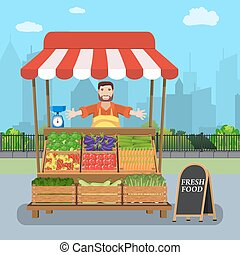 male street vendor selling vegetables from his stall on city...